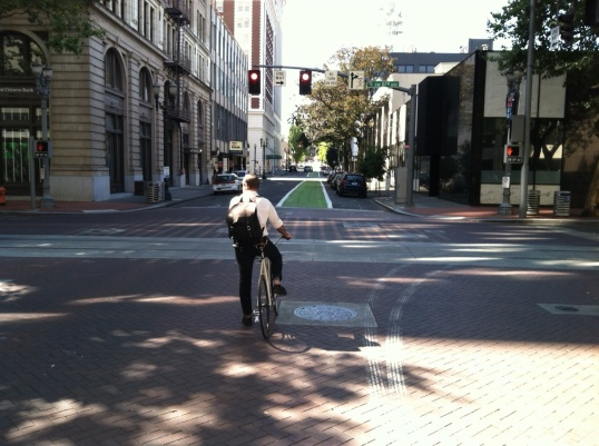 Portland has added green paint to improve the visibility of bike routes on several of its streets.  Green bike boxes are also common at major intersections.