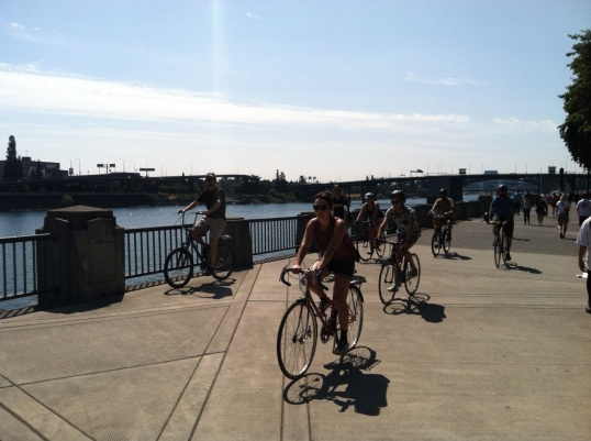 Cyclists on Portland's waterfront parkway, until the 1970s, this space was occupied by a highway.